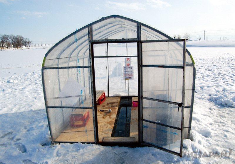 Inside a vinyl ice fishing tent at Shinshinotsu Village Tappu no Tsuriba