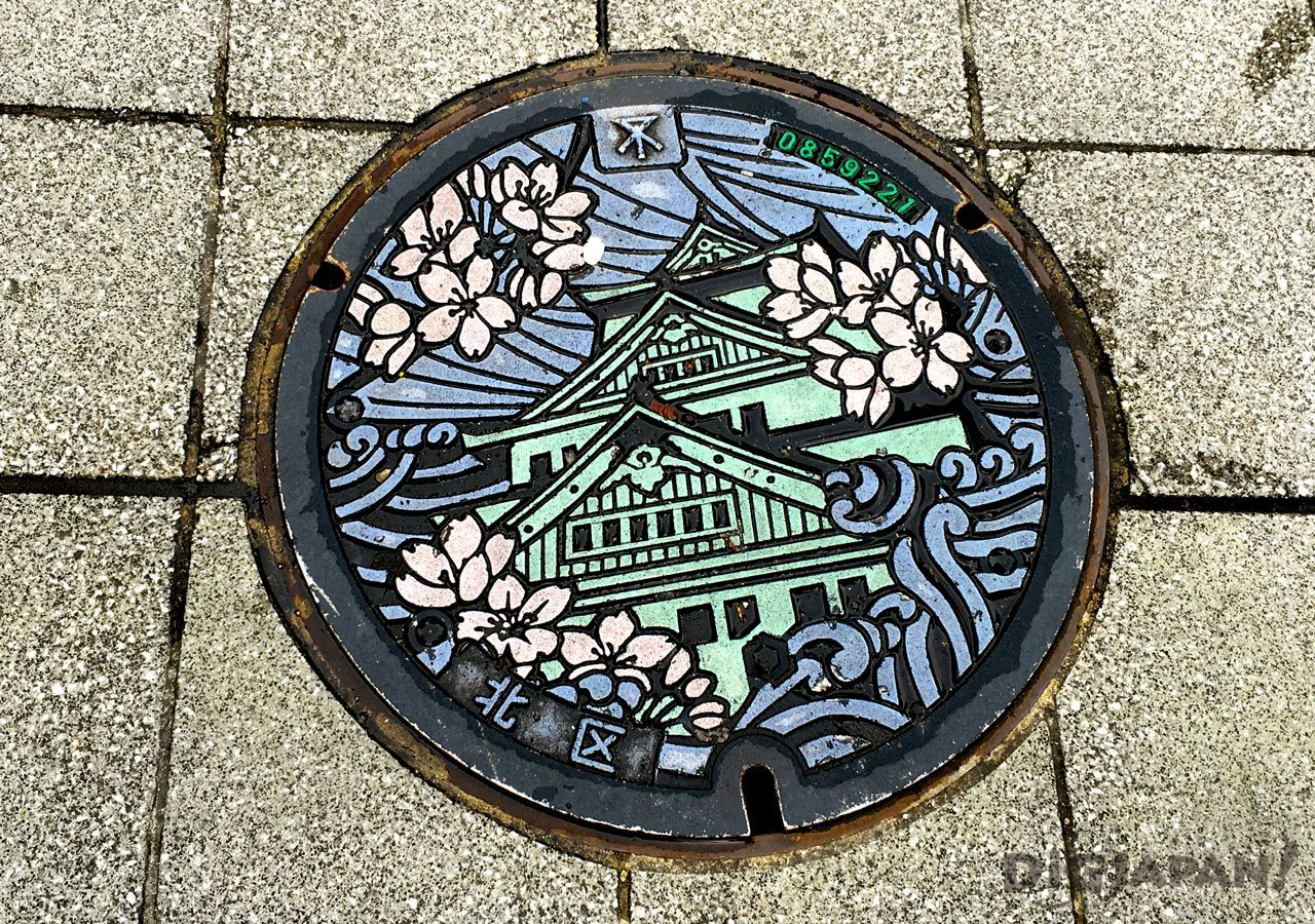 Manhole cover art Osaka Castle sakura