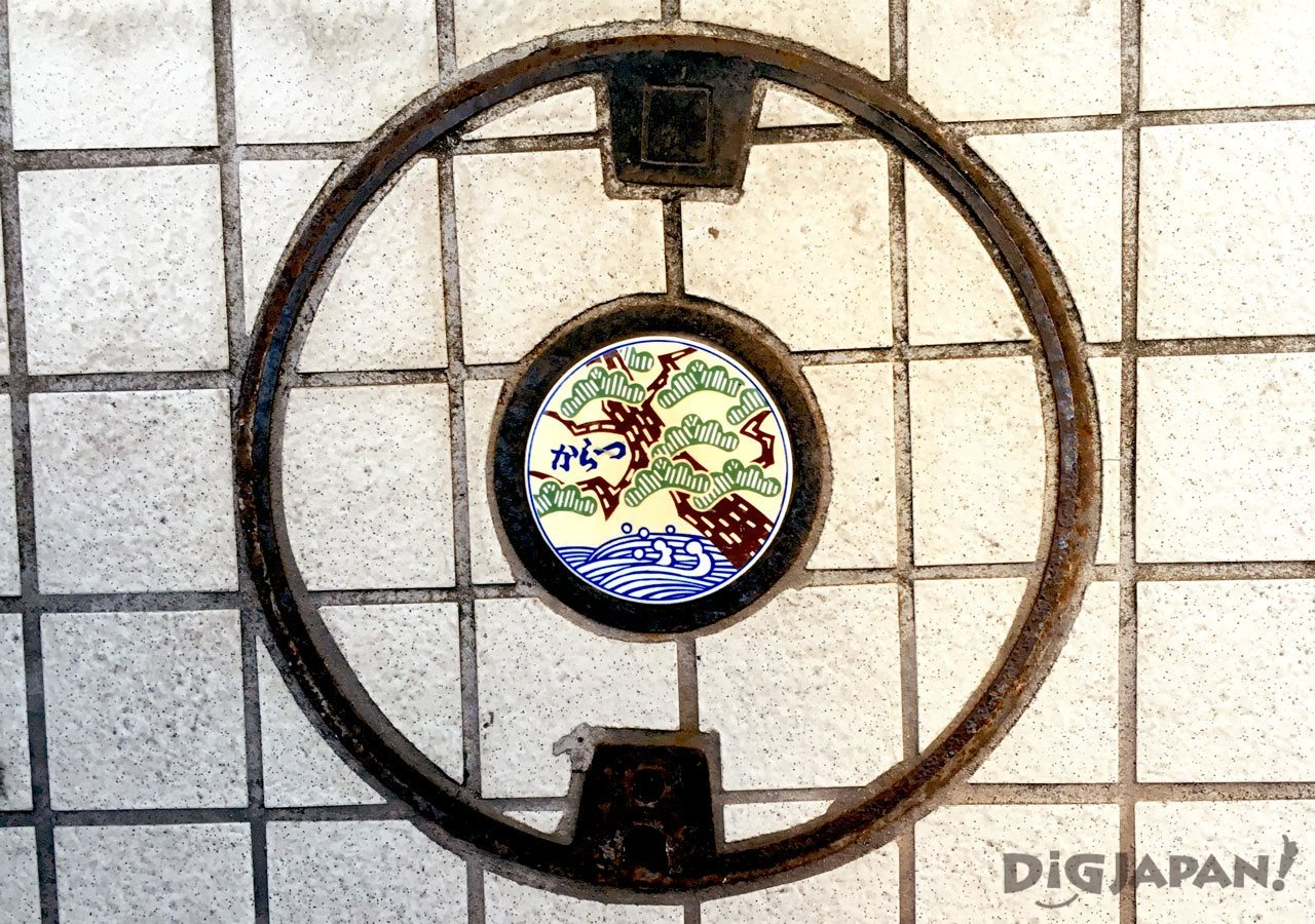 Manhole cover art Karatsu Saga pine trees ocean
