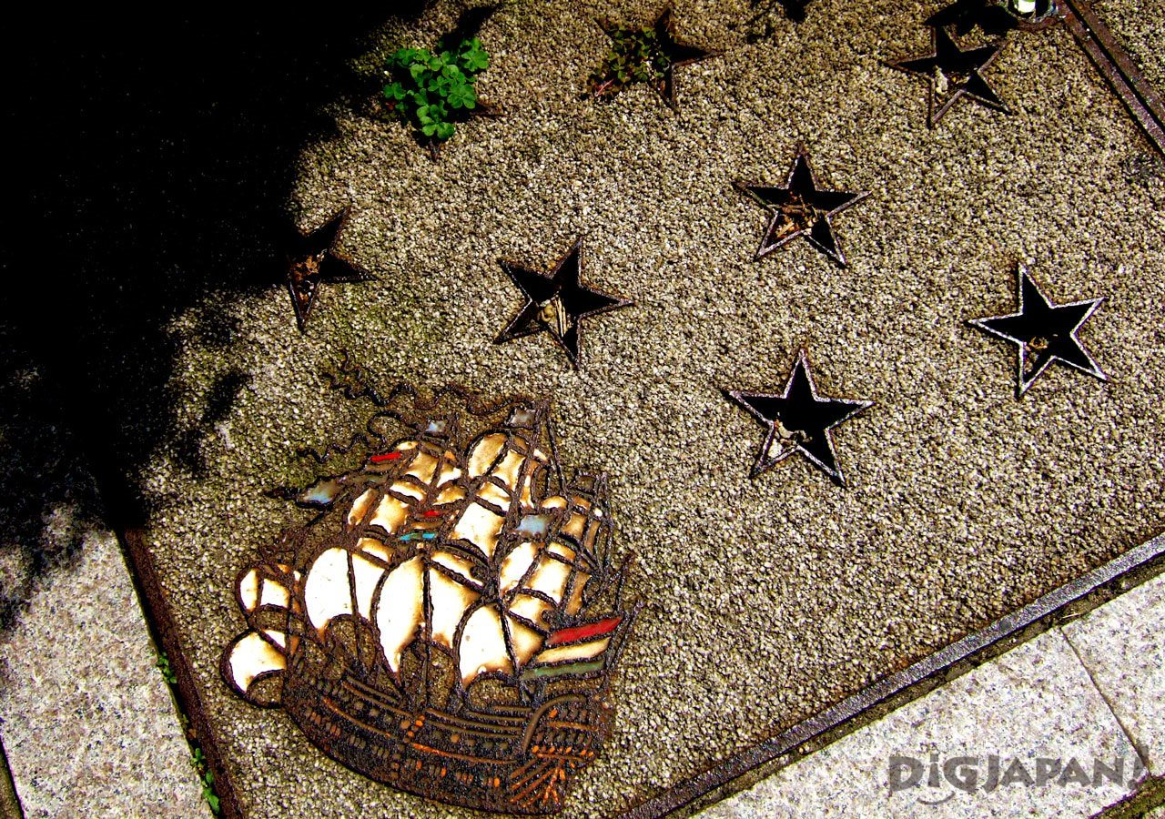 Manhole cover art nagasaki tall ship stars