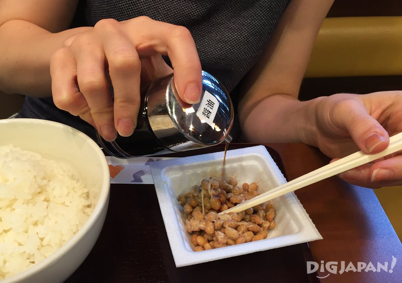 Mixing natto with soy sauce