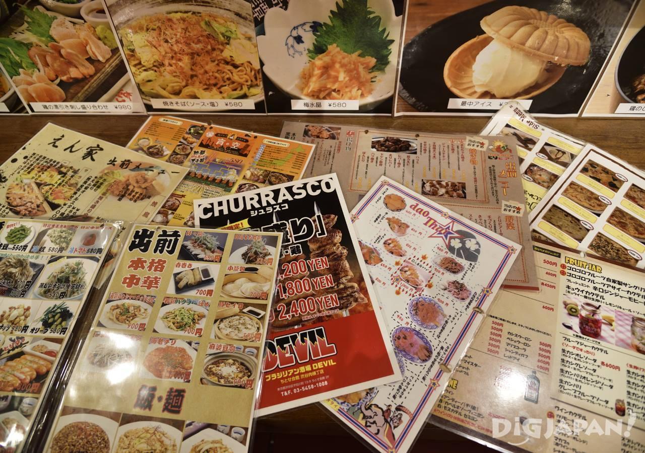 Menus from the various restaurants inside Niku Yokocho