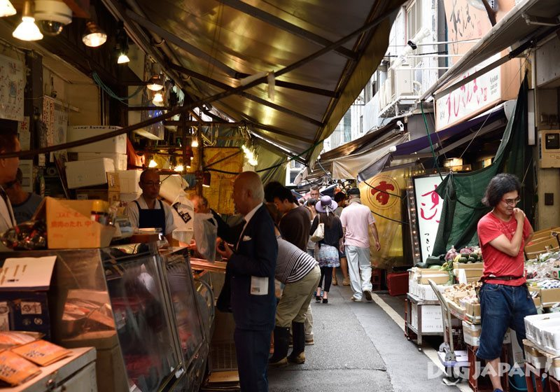 Many shops line the narrow streets of Tsukiji market