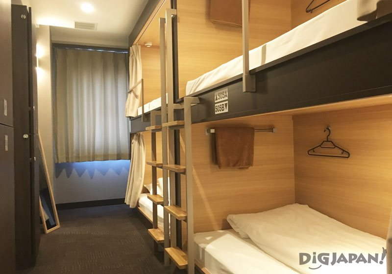 Dormitory-style room at EMBLEM Hostel