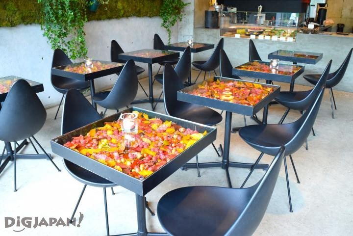Black box tables filled with flowers