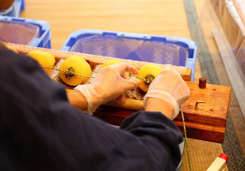 Stringing persimmons