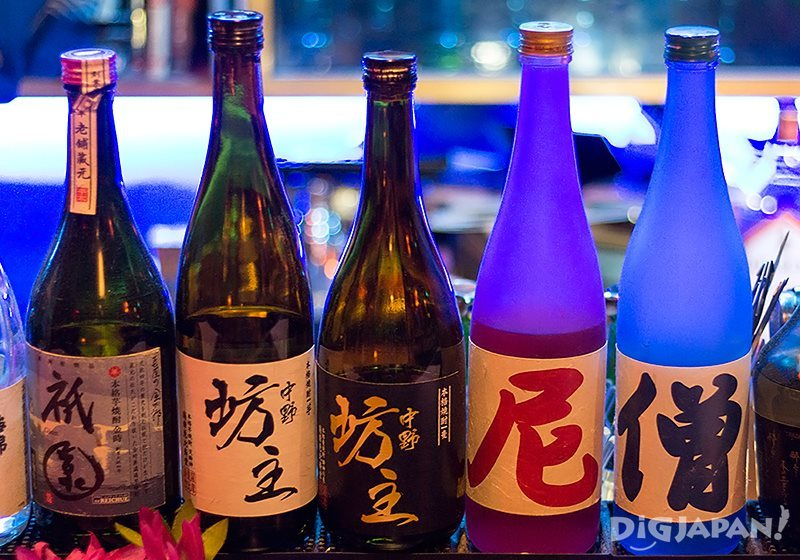 "Shochu bottles with original labels. The blue bottle says ""priest"" and the pink bottle says ""priestess""."