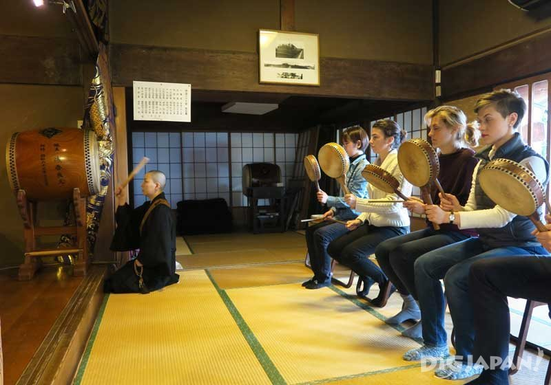 Playing drums in a Buddhist ceremony