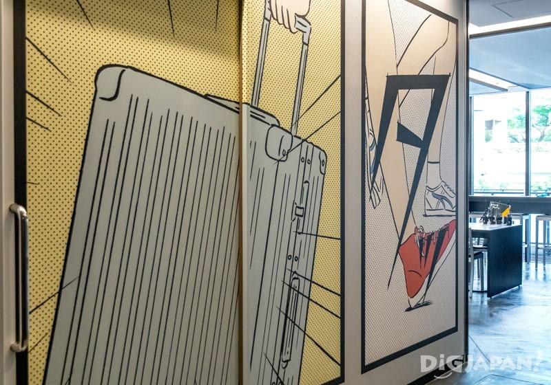 占据整面墙大小的行李箱漫画涂鸦